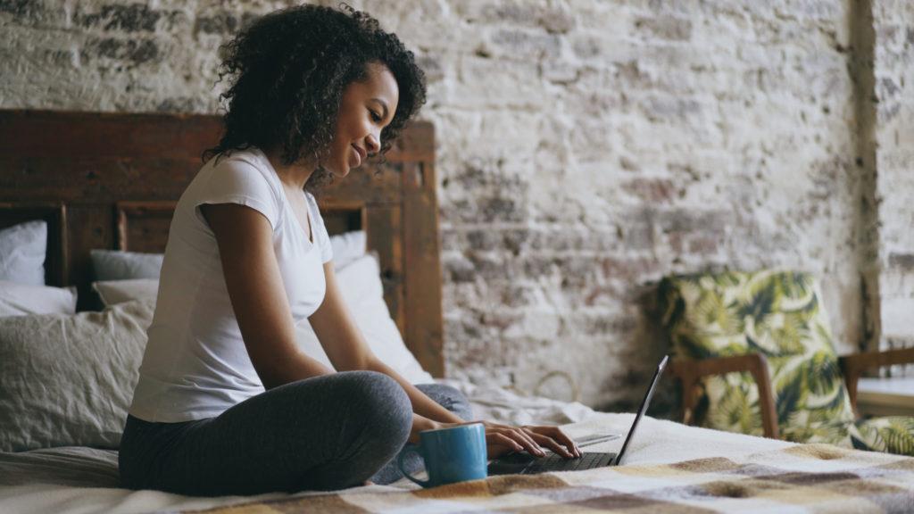 Woman shopping for a budget mattress online