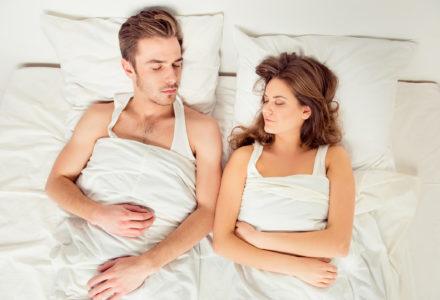 Young couple sleeping on their backs