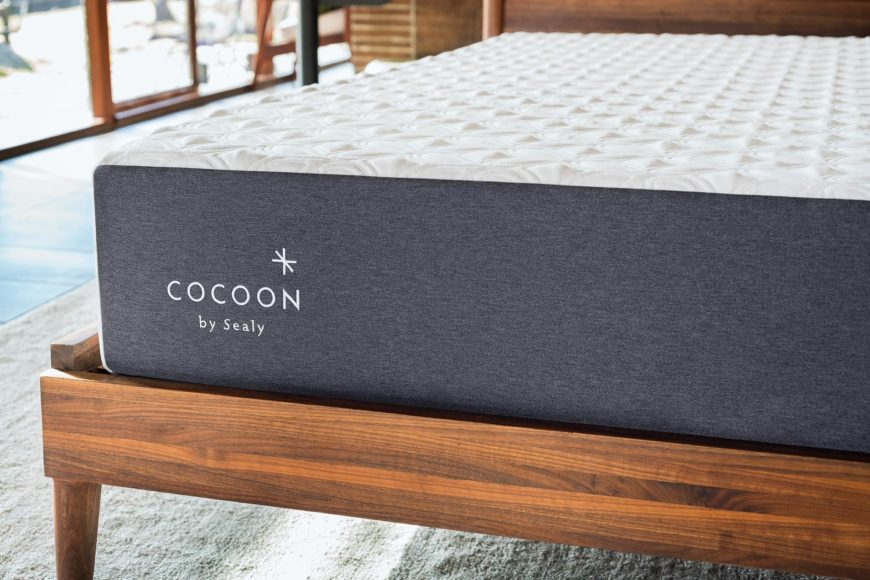Close up of the Cocoon mattress on a wooden bed frame