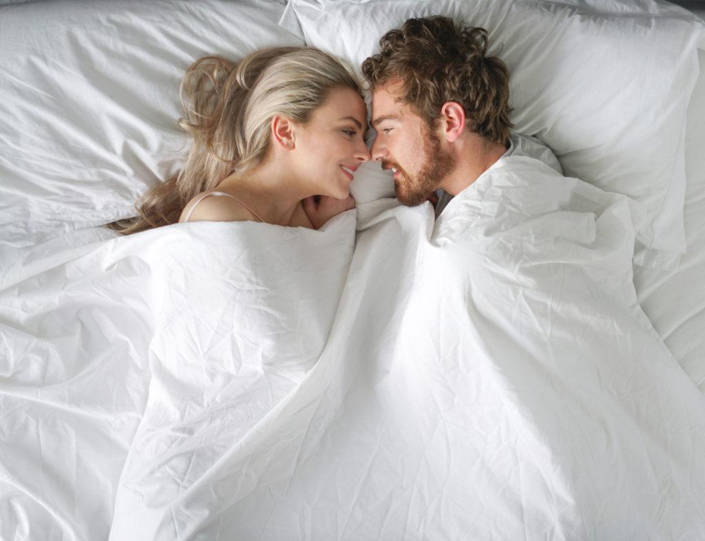 couple snuggling e1541170924958