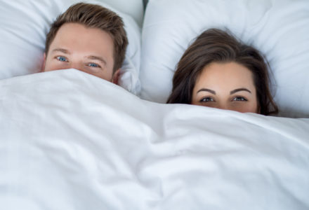 Young couple who just found the best mattress for their sleep style