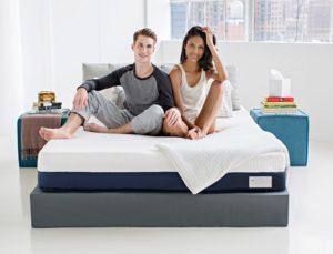 Couple sitting on a Helix mattress