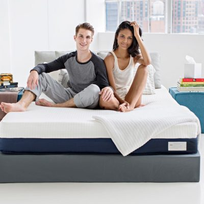 Couple sitting on a Helix mattress