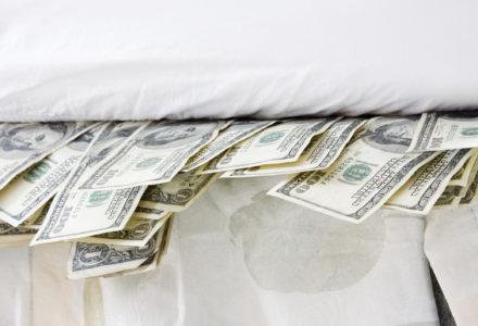 Money stuffed under mattress
