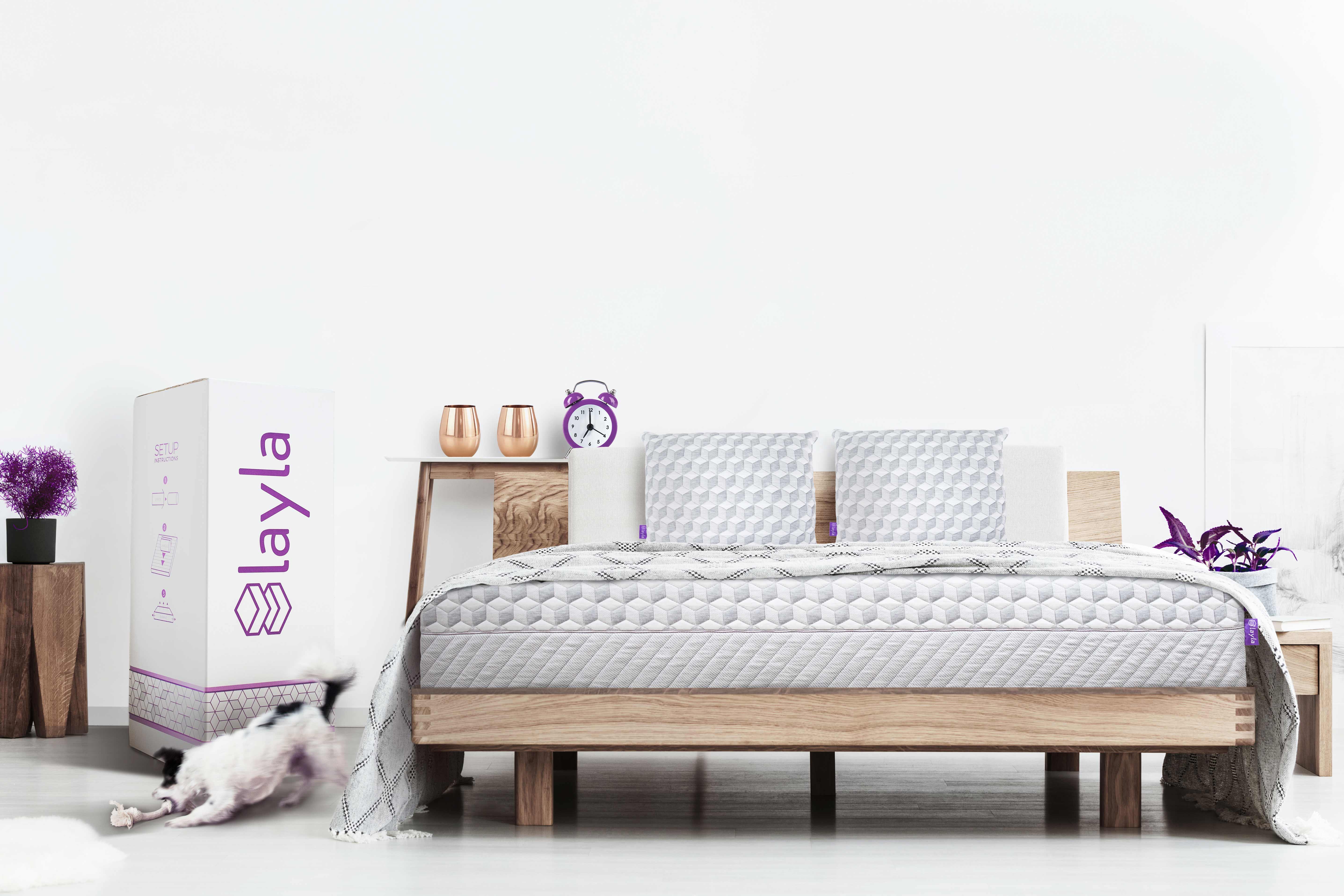 Layla mattress sitting on a bedframe