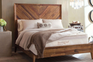 Loom & Leaf mattress in a bedroom on a wooden foundation with headboard