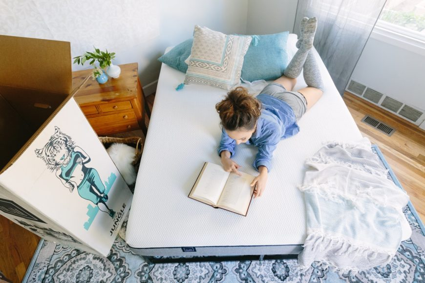 Young woman reading a book on a Lull mattress