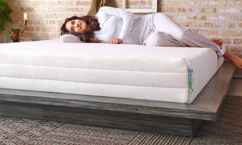 lady laying on a mattress