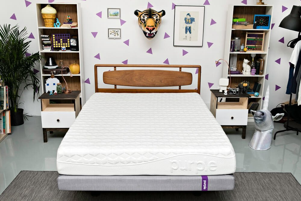Purple mattress in a bedroom