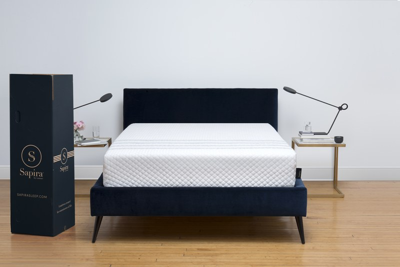 Sapira mattress in a modern bedroom next to Sapira box
