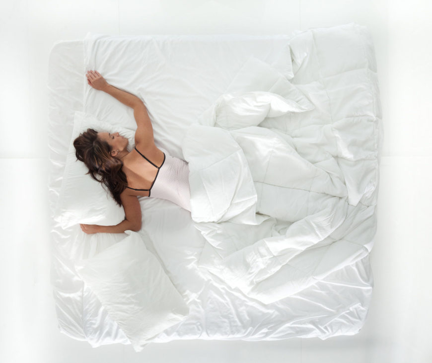 Woman on a king-size mattress