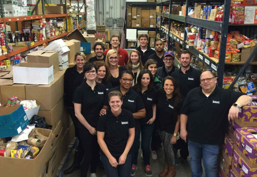 Leesa employees volunteering at a local food bank