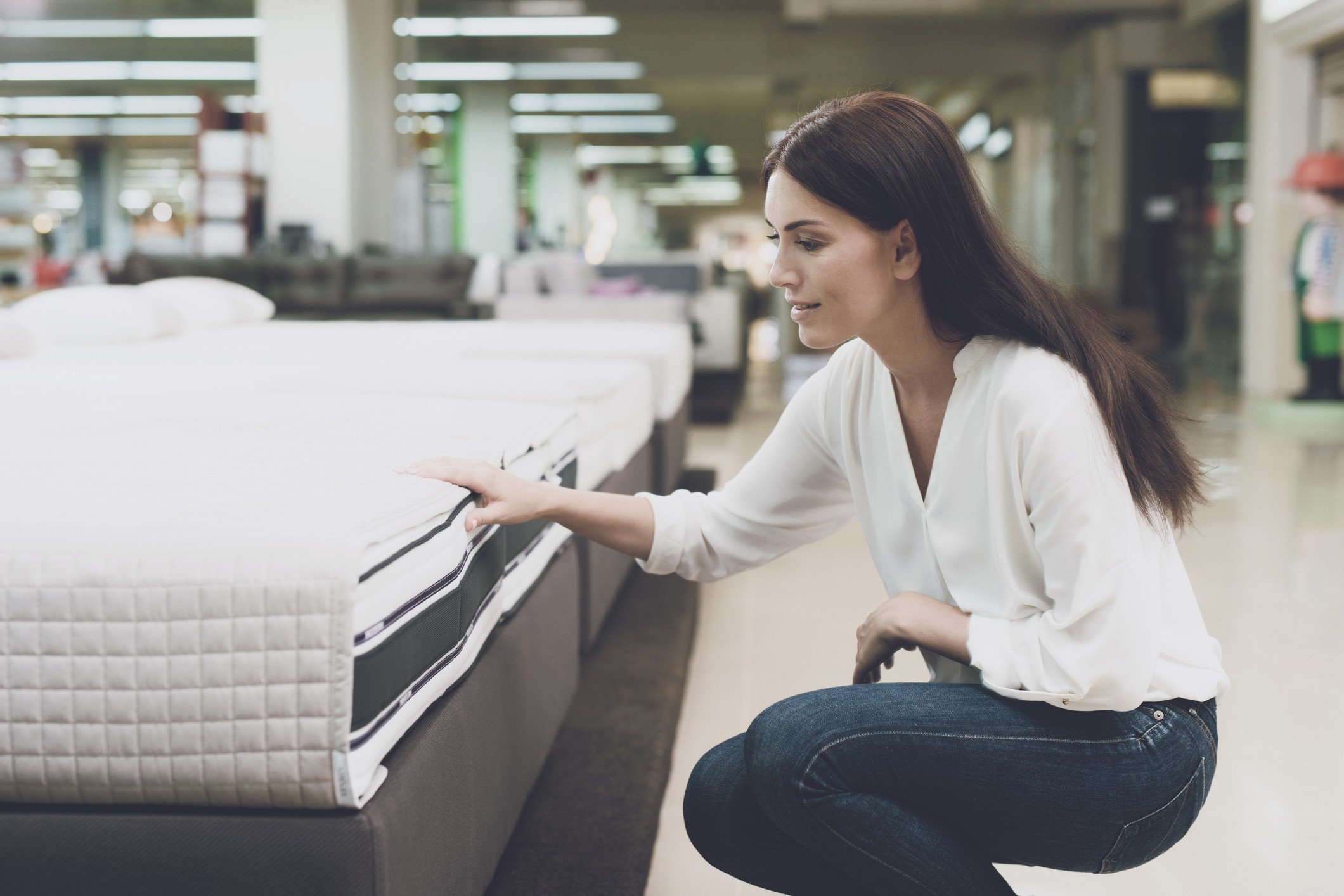 A woman shopping for a mattress