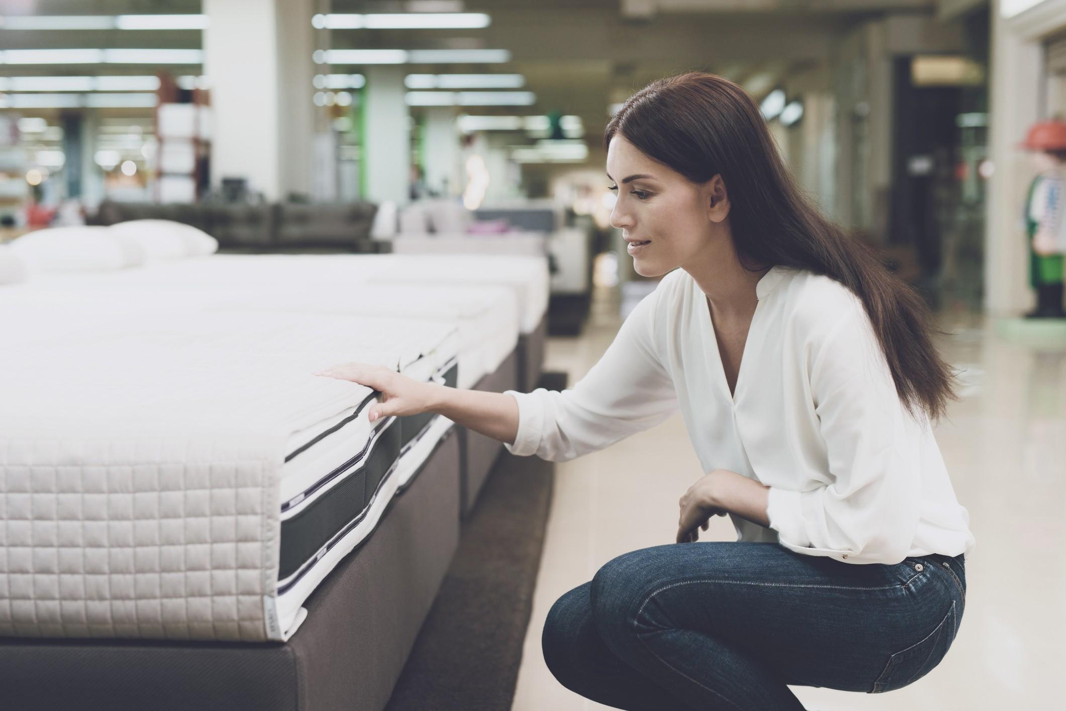 A woman shopping for a mattress