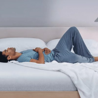 Man laying on a Casper Wave mattress
