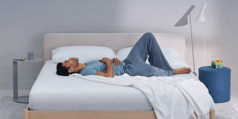 Man laying on a Casper Wave mattress