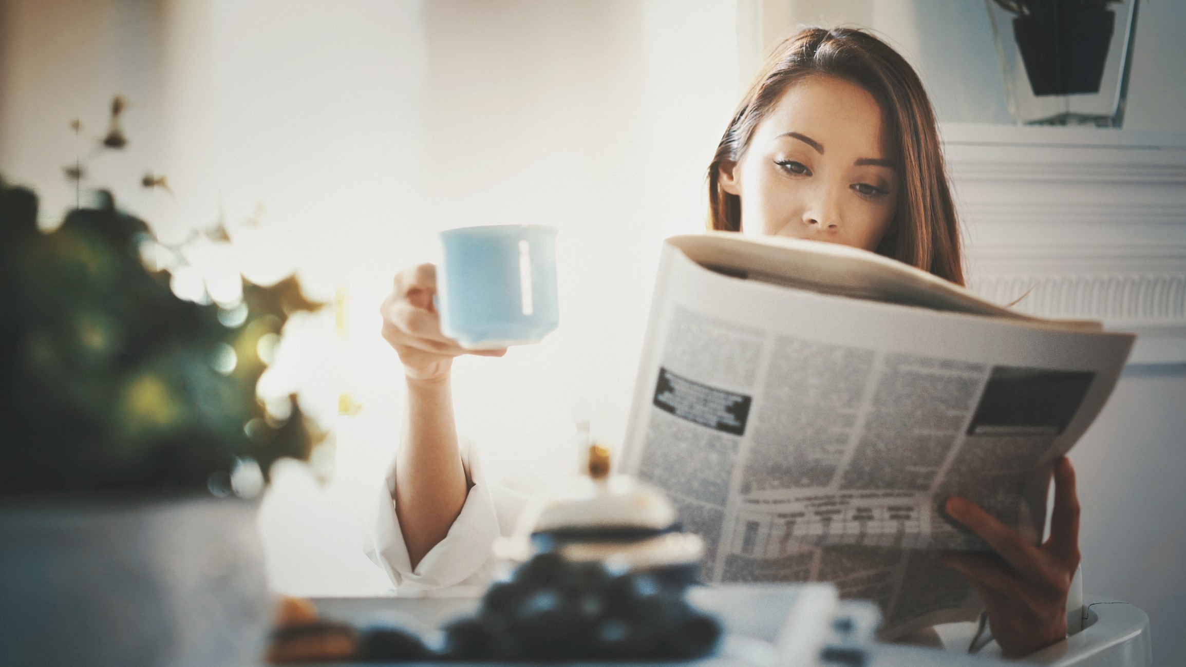 Morning routine with coffee and newspaper
