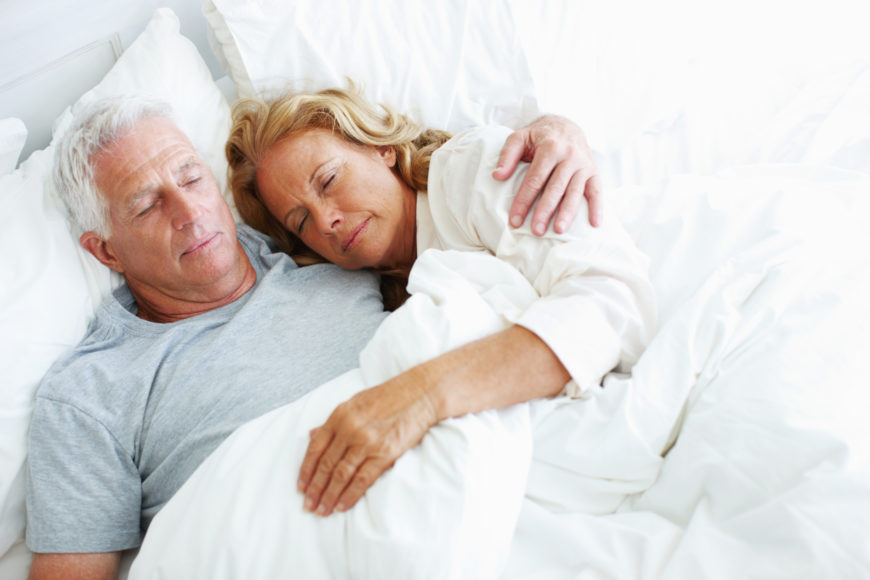 Elderly couple sleeping