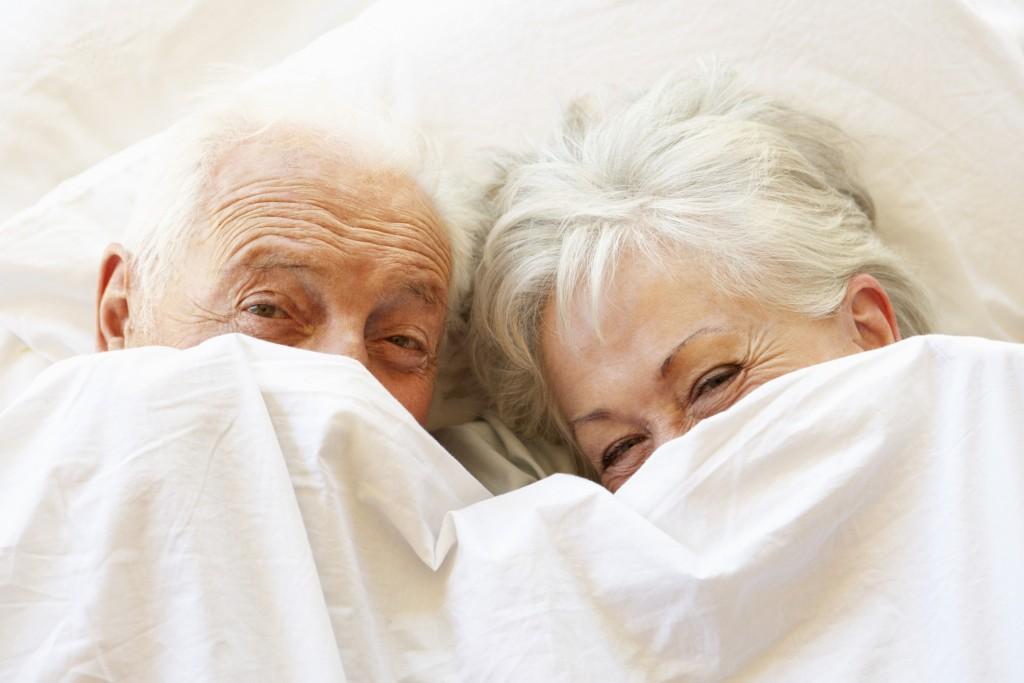 happy elderly couple in bed