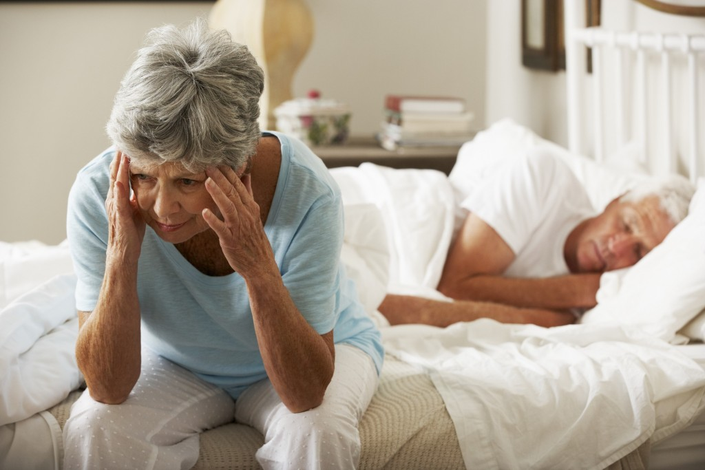 sleep deprived older woman