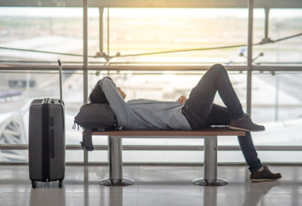 Man sleeping at an airport