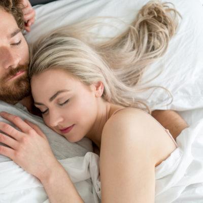 Loving couple sleeping together
