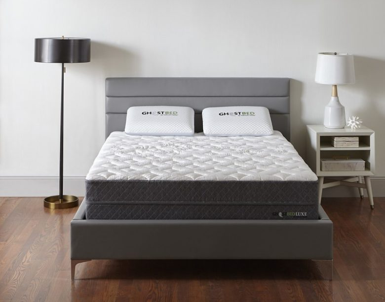 GhostBed Luxe cooling mattress on a mattress foundation in a bedroom