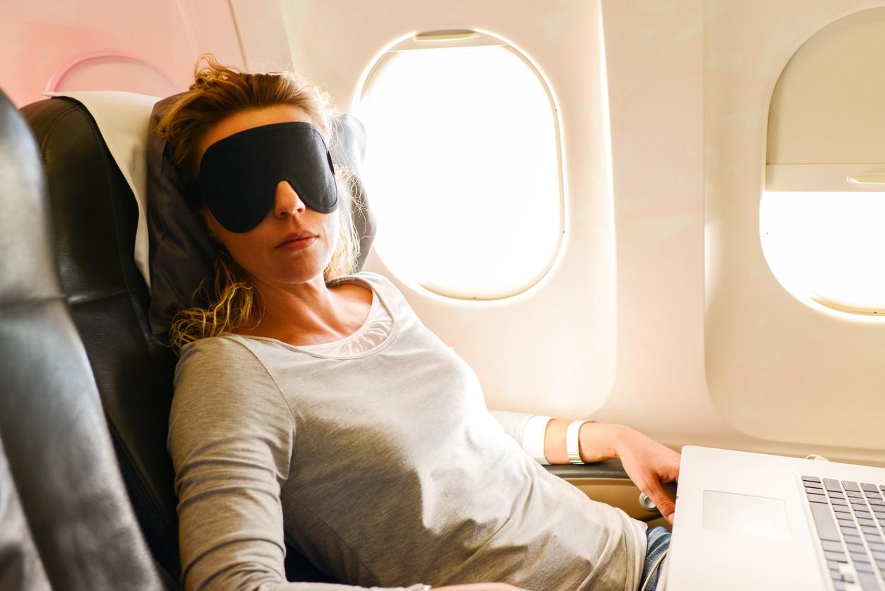 Woman sleeping on a plane