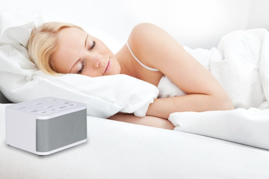 Woman sleeping with white noise machine