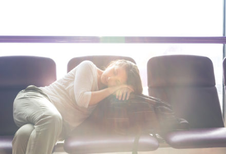 Woman sleeping in airport