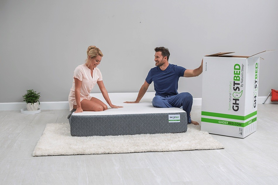 Couple sitting on the Ghostbed mattress