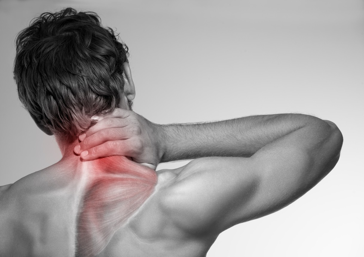 Image of a man grabbing his neck. The area of pain he feels is illuminated in red
