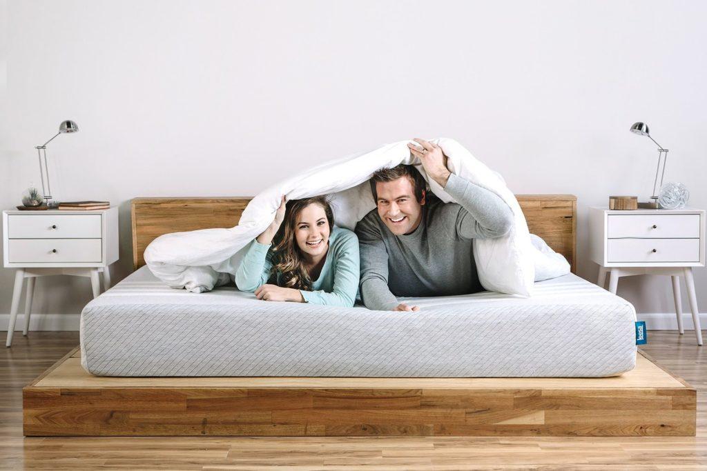 Couple reviewing the Leesa mattress