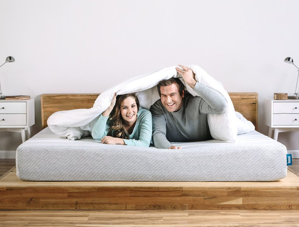 Couple laying on the Leesa mattress