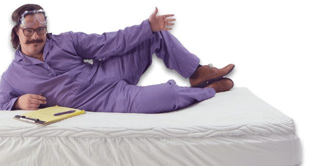Purple man sitting on the Purple mattress
