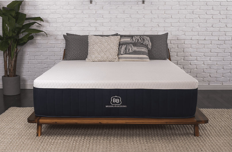 Brooklyn Bedding Aurora mattress on a bed frame in a bedroom