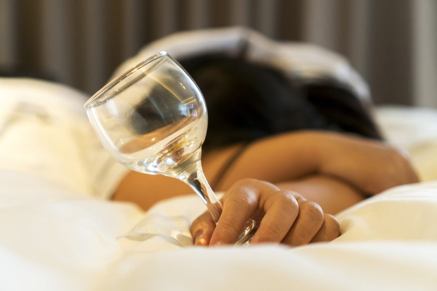 drunk girl sleeping on bed
