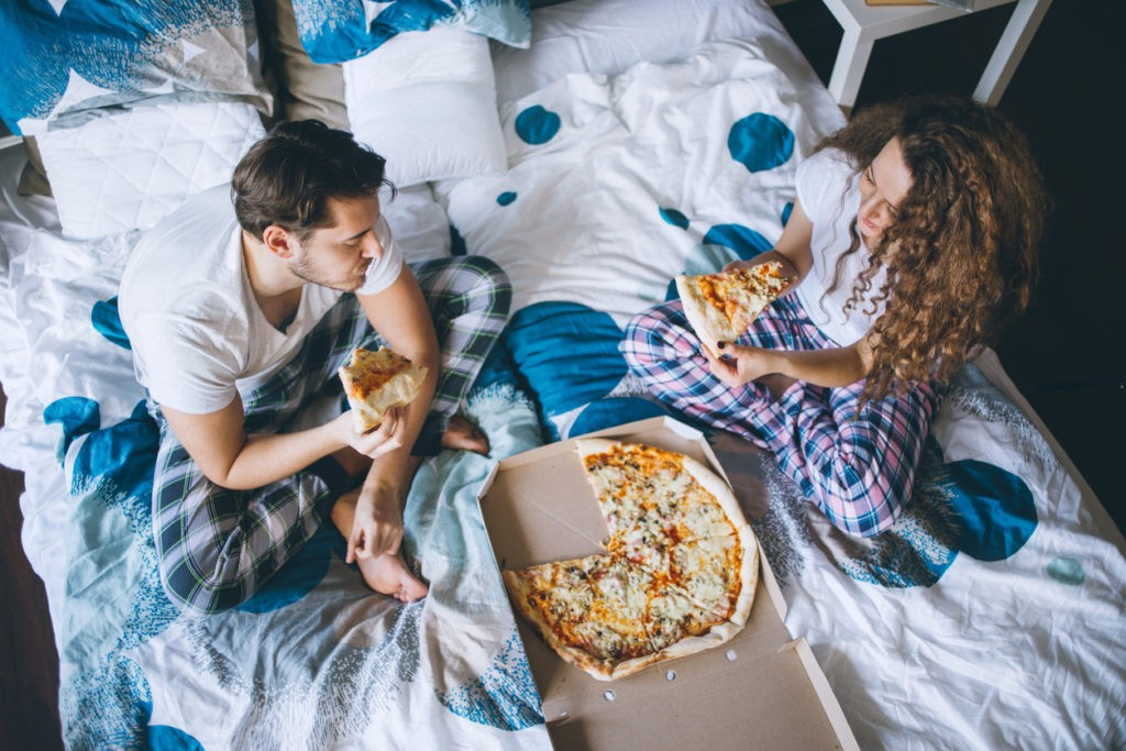 Eating pizza in bed