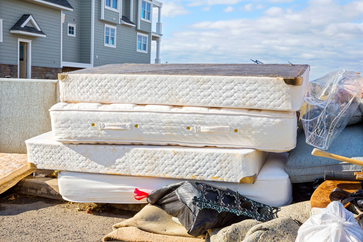 Mattress's put out on the curb as trash
