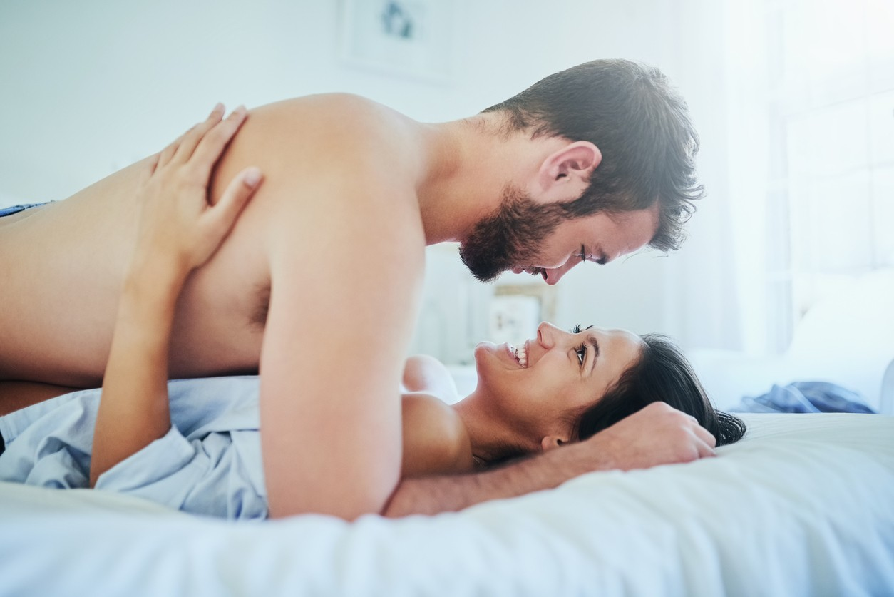 Shot of a young couple sharing an intimate moment in their bedroom