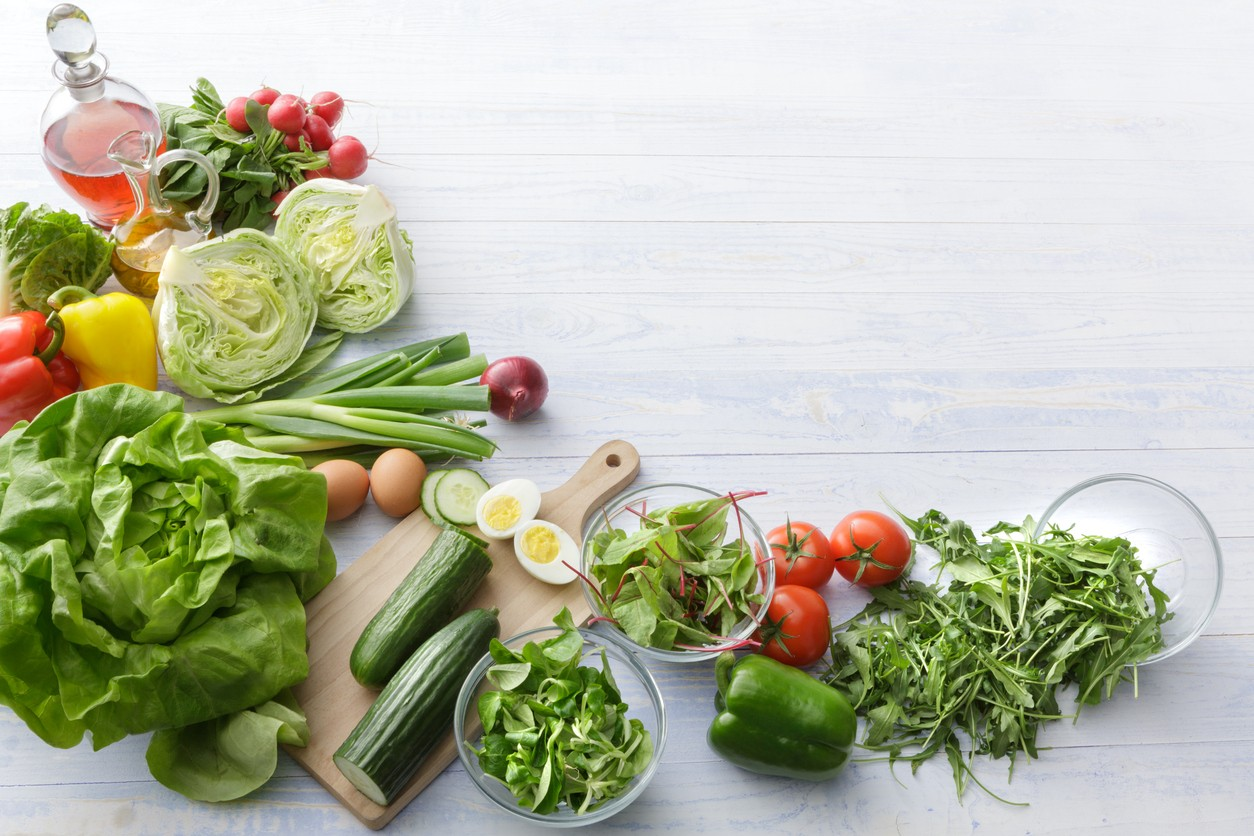 Image of diverse diet: leafy greens, eggs, veggies and fruits