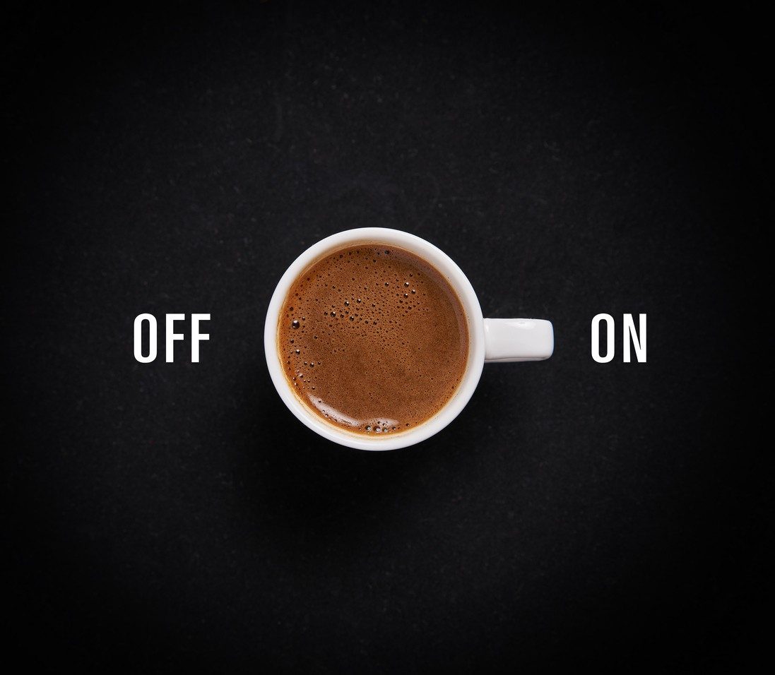 Cup of coffee on black background like switch button
