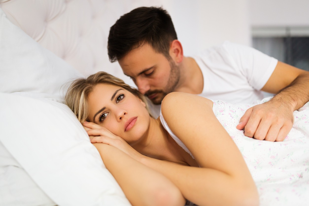 Young unhappy couple having problems in their relationship