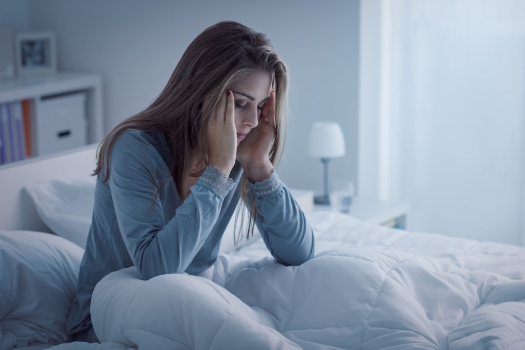 Woman with insomnia lying awake at night
