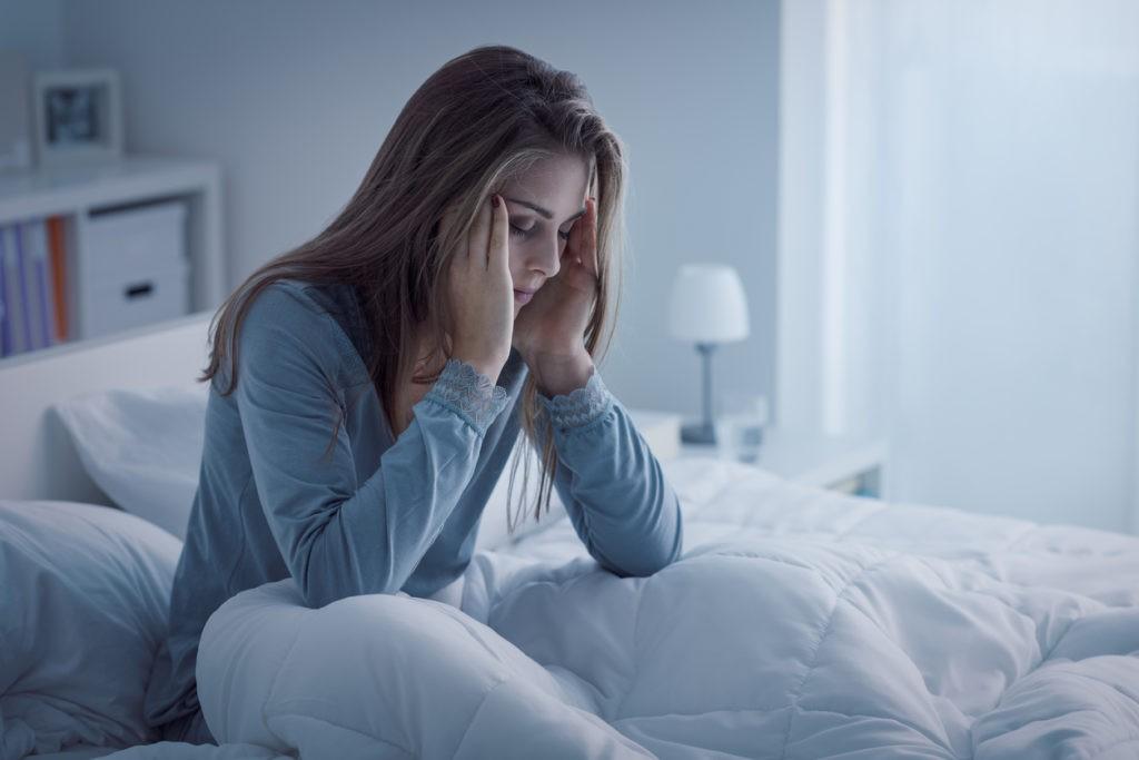 Woman with insomnia lying awake at night