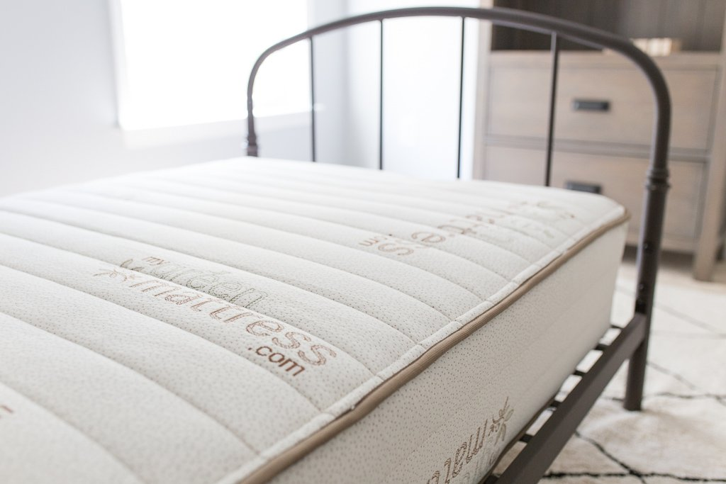 Pure Echo Twin size Mattress on a bedframe in a room