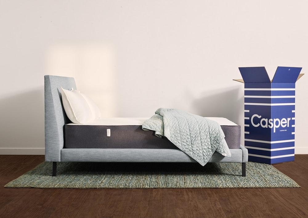 Casper mattress side view next to box