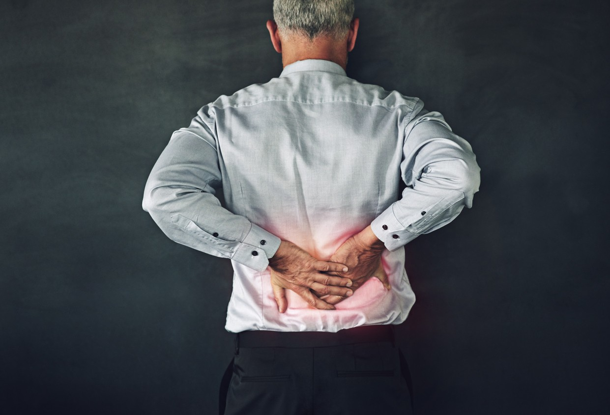 Studio shot of a mature man experiencing muscular strain