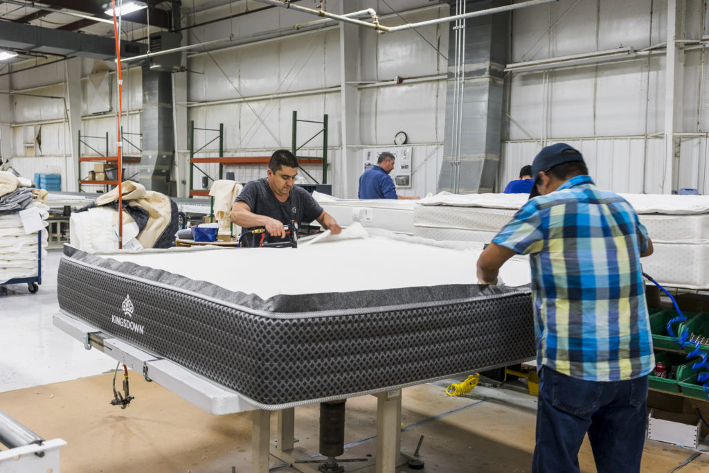 Factory workers assembling a Kingsdown mattress