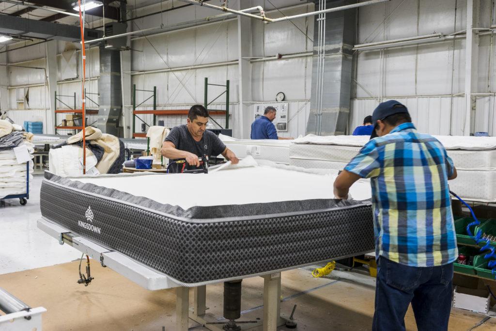 Factory workers assembling a Kingsdown mattress